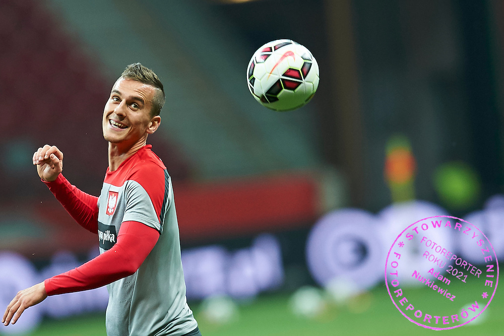 Poland's Arkadiusz Milik looks on the ball during official training one day before the EURO 2016 qualifying match between Poland and Germany on October 10, 2014 at the National stadium in Warsaw, Poland<br /> <br /> Picture also available in RAW (NEF) or TIFF format on special request.<br /> <br /> For editorial use only. Any commercial or promotional use requires permission.<br /> <br /> Mandatory credit:<br /> Photo by &copy; Adam Nurkiewicz / Mediasport