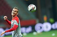 Poland's Arkadiusz Milik looks on the ball during official training one day before the EURO 2016 qualifying match between Poland and Germany on October 10, 2014 at the National stadium in Warsaw, Poland<br /> <br /> Picture also available in RAW (NEF) or TIFF format on special request.<br /> <br /> For editorial use only. Any commercial or promotional use requires permission.<br /> <br /> Mandatory credit:<br /> Photo by © Adam Nurkiewicz / Mediasport