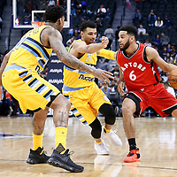 18 November 2016: Denver Nuggets forward Wilson Chandler (21) and Denver Nuggets guard Jamal Murray (27) defends on Toronto Raptors guard Cory Joseph (6) during the Toronto Raptors 113-111 OT victory over the Denver Nuggets, at the Pepsi Center, Denver, Colorado, USA.