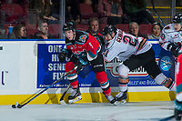 KELOWNA, CANADA - OCTOBER 13: Matteo Gennaro #21 of the Calgary Hitmen back checks Konrad Belcourt #5 of the Kelowna Rockets at the boards as he skates with the puck on October 13, 2017 at Prospera Place in Kelowna, British Columbia, Canada.  (Photo by Marissa Baecker/Shoot the Breeze)  *** Local Caption ***