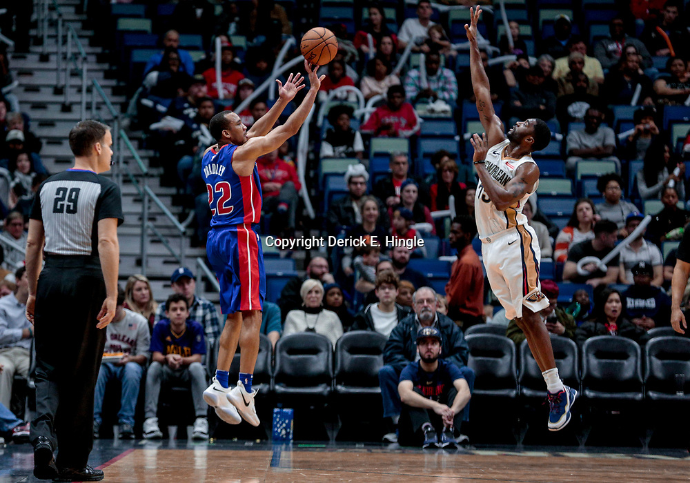 Jan 8, 2018; New Orleans, LA, USA; Detroit Pistons guard Avery Bradley (22) shoots over New Orleans Pelicans guard E'Twaun Moore (55) during the second half at the Smoothie King Center. The Pelicans defeated the Pistons 112-109. Mandatory Credit: Derick E. Hingle-USA TODAY Sports