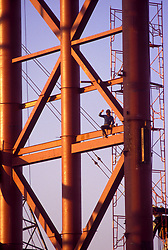 Stock photo of steel workers at sunrise on the original construction of the George R. Brown Convention Center in Houston, Texas.