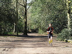 © Licensed to London News Pictures. 07/04/2015. London, UK. A jogger runs in the sunshine and warm spring weather in Holland Park in west London this morning. Photo credit : Vickie Flores/LNP