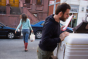 "Kate and Dan make a food delivery to a customer in Upper Manhattan. It takes them most of a day to drive the three hours from Stony Creek to the city and make six or eight delivery stops, sales totaling at roughly $1,300. Kate figures she makes 25 percent profit on her products this way, as opposed to 10 percent if she sold the food to a wholesaler. Although it's not a lucrative endeavour, Kate said, ""I have to sell my product."""