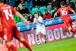 Benjamin Verbič of Slovenia vs Boban Nikolov of Macedonia and Darko Velkoski of Macedonia during football match between National teams of Slovenia and North Macedonia in Group G of UEFA Euro 2020 qualifications, on March 24, 2019 in SRC Stozice, Ljubljana, Slovenia.  Photo by Matic Ritonja / Sportida