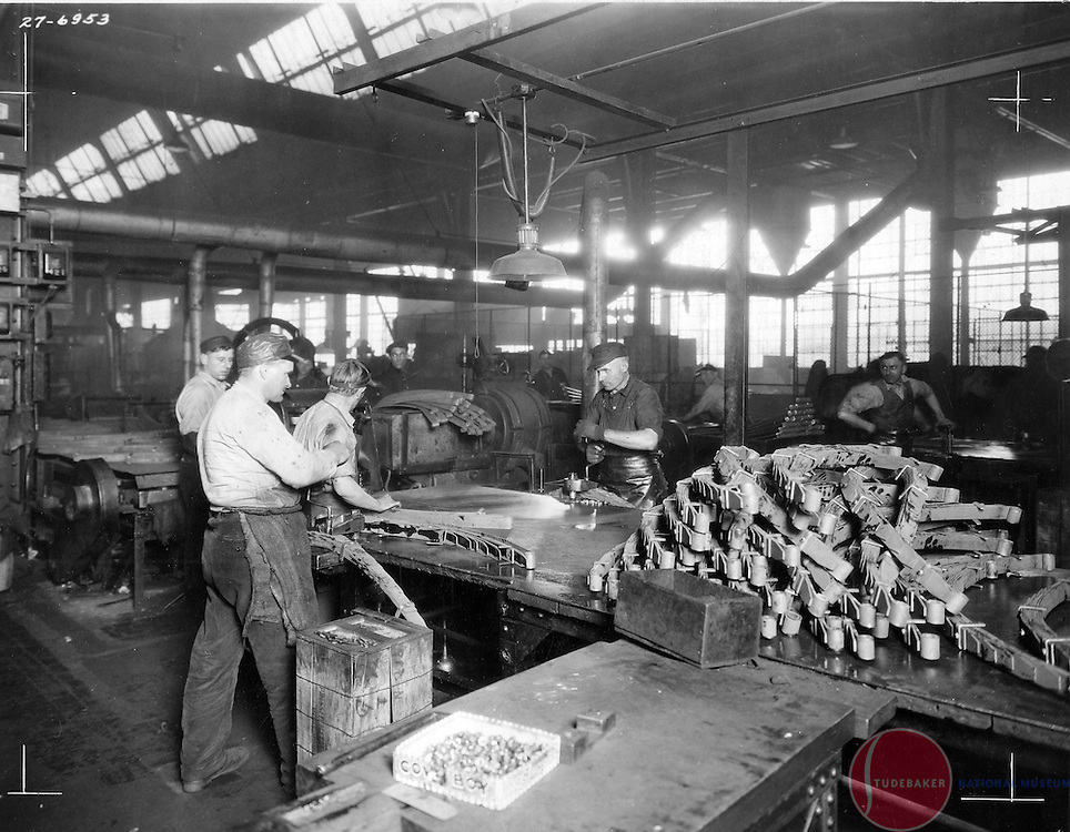 Studebaker workers assemble leaf springs in Studebaker's spring shop.  This image was taken in mid-1927.