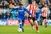 Gillingham FC forward Brandon Hanlan (7) and Sunderland midfielder Grant Leadbitter (23) during the EFL Sky Bet League 1 match between Gillingham and Sunderland at the MEMS Priestfield Stadium, Gillingham, England on 7 December 2019.