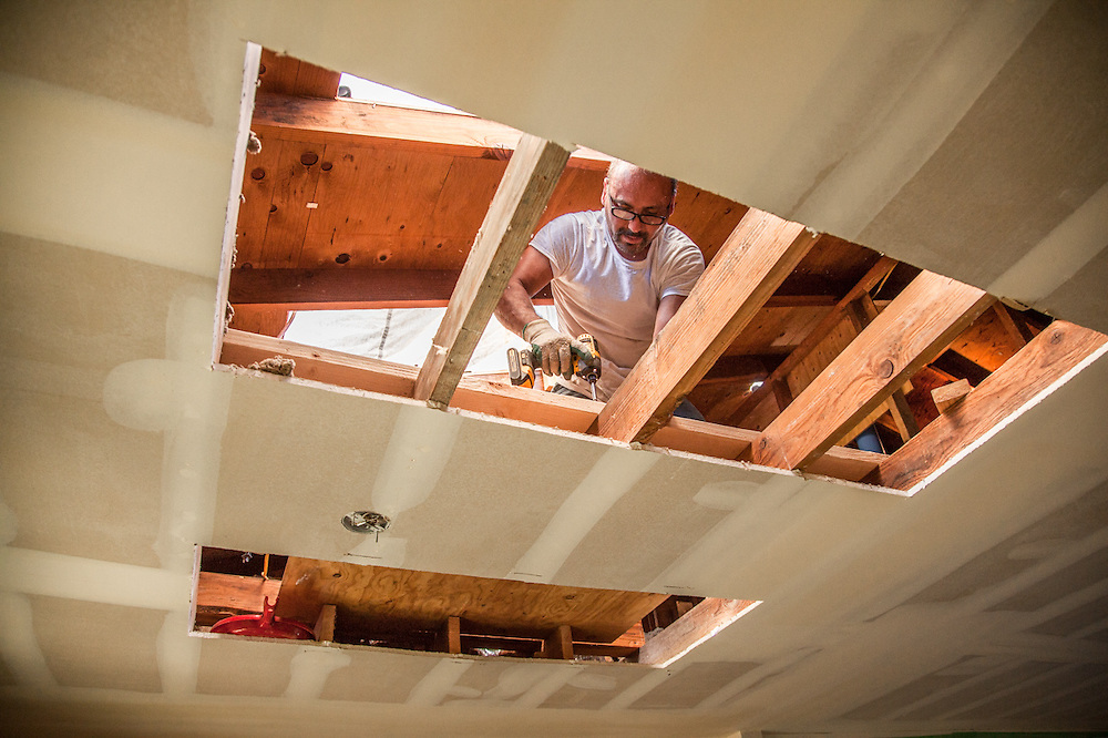 Tommy Guteirrez frames in holes in the ceiling and roof in preparation of installing skylights in our Calistoga home.