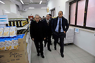 Roma  6 Novembre  2009..Il Direttore della Caritas Diocesana di Roma mons. Enrico Feroci  con in Presidente della Provincia di Roma Nicola Zingaretti e Claudio Cecchini Assessore alle Politiche Sociali della Provincia di Roma in visita all' Emporio Caritas..The Director of Caritas of Rome Monsignor  Enrico Feroci and the president of the province in Rome Nicola  Zingaretti..Emporio Caritas is a real supermarket medium-sized (around 500 square metres) with automated boxes, trolleys, shelves and insignia. Of it can benefit not only residents but also those who are deprived of residence and not have a permanent residence, subject to authorisation Centres Listening and Parrocchiali Diocesan Caritas and institutions have joined the project..