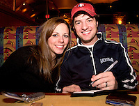 Newlywed Couple Kristin and Brandon Hill Happily Paying Bills After Dinner at the Plaza, Kansas City, Missouri