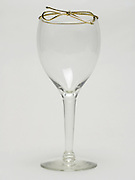 wine glass with a golden gift wrap tie