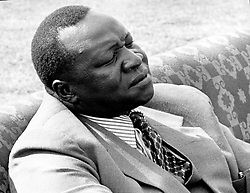 Oct 29, 1974; Kampala, Uganda; The Ugandan people celebrated the 11th anniversary of Independence.Since 1971 the country has been ruled by President IDI AMIN DADA, who told the people in an Anniversary speech that they had achieved more in their few years of independence than in the seventy years they had spent under British colonial rule. The picture shows General Amin seated in a comfortable chair, watching a parade staged for the celebration at Kampala's Nakivubu Stadium. (Credit Image: © Keystone Press Agency/Keystone USA via ZUMAPRESS.com)