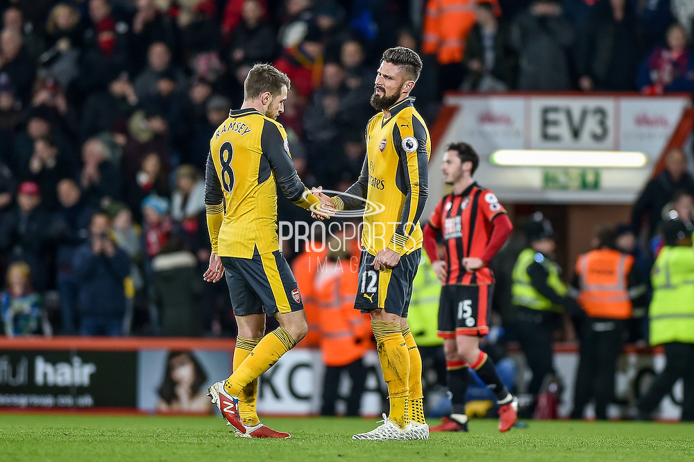 Arsenal Forward, Olivier Giroud (12) and Arsenal Midfielder, Aaron Ramsey (8) at the final whistle during the Premier League match between Bournemouth and Arsenal at the Vitality Stadium, Bournemouth, England on 3 January 2017. Photo by Adam Rivers.
