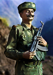 An Indian soldier watches smoke billow after a rocket was launched at armed militants  hiding in a villagers house who infiltrated the Poonch district of Jammu along the Line of Control between Pakistan and India Friday, November 2, 2001. The militants were allegedly crossing the border to fight for the jihad in Kashmir. (Getty Images/Ami Vitale)