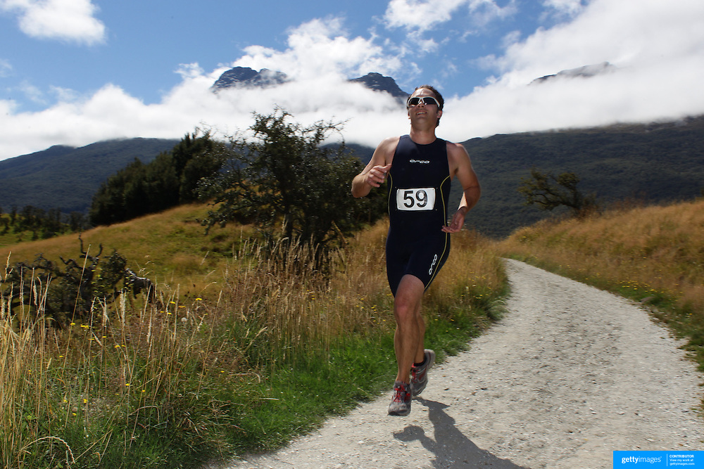 Dave Mack in action during the run leg of the Paradise Triathlon and Duathlon series with breathtaking views of Mount Aspiring National Park, Paradise, Glenorchy, South Island, New Zealand. 18th February 2012. Photo Tim Clayton