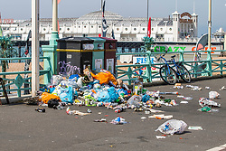 © Licensed to London News Pictures. 26/06/2020. Brighton, UK. Council workers have been working all morning on cleaning up the beach after tons of rubbish was left on Thursday by visitors to Brighton and Hove seaside. Photo credit: Hugo Michiels/LNP