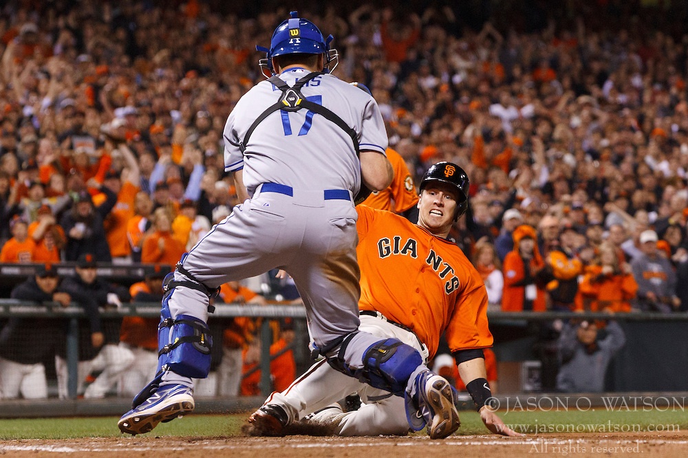 SAN FRANCISCO, CA - MAY 03:  Buster Posey #28 of the San Francisco Giants is tagged out at home plate by A.J. Ellis #17 of the Los Angeles Dodgers during the sixth inning at AT&T Park on May 3, 2013 in San Francisco, California. (Photo by Jason O. Watson/Getty Images) *** Local Caption *** Buster Posey; A.J. Ellis