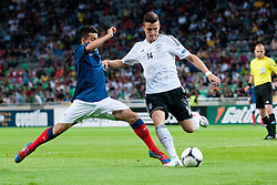 Marc Oliver Kempf of Germany and Corentin Jean of France crashes and referee gives penalty for France during the UEFA European Under-17 Championship Group A match between Germany and France on May 10, 2012 in SRC Stozice, Ljubljana, Slovenia. Germany defeated France 3:0. (Photo by Matic Klansek Velej / Sportida.com)