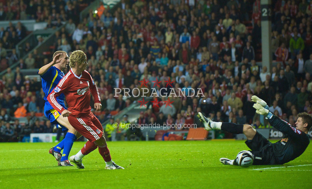 LIVERPOOL, ENGLAND - Tuesday, September 23, 2008: Liverpool's Fernando Torres is denied by Crewe Alexandra's goalkeeper Steve Collis during the League Cup 3rd round match at Anfield. (Photo by David Rawcliffe/Propaganda)