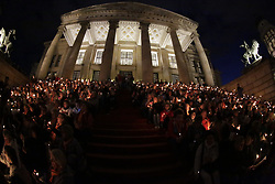 May 24, 2017 - Berlin, Germany - People are sitting with candles on the steps of the Konzerthaus Berlin (concert hall). The opening day of the 36th Kirchentag ended with the traditional blessing with candles. The 36th German Protestant Church Congress is held in Berlin and coincides with the 500. anniversary of the Reformation. (Credit Image: © Michael Debets/Pacific Press via ZUMA Wire)