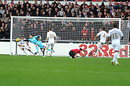 Swansea city keeper Michel Vorm and Ashley Williams clear a goal effort from Utd's Javier Hernandez (on ground).Barclays premier league, Swansea city v Manchester Utd at the Liberty stadium in Swansea, South Wales on Sunday 23rd Dec 2012. pic by Andrew Orchard, Andrew Orchard sports photography,