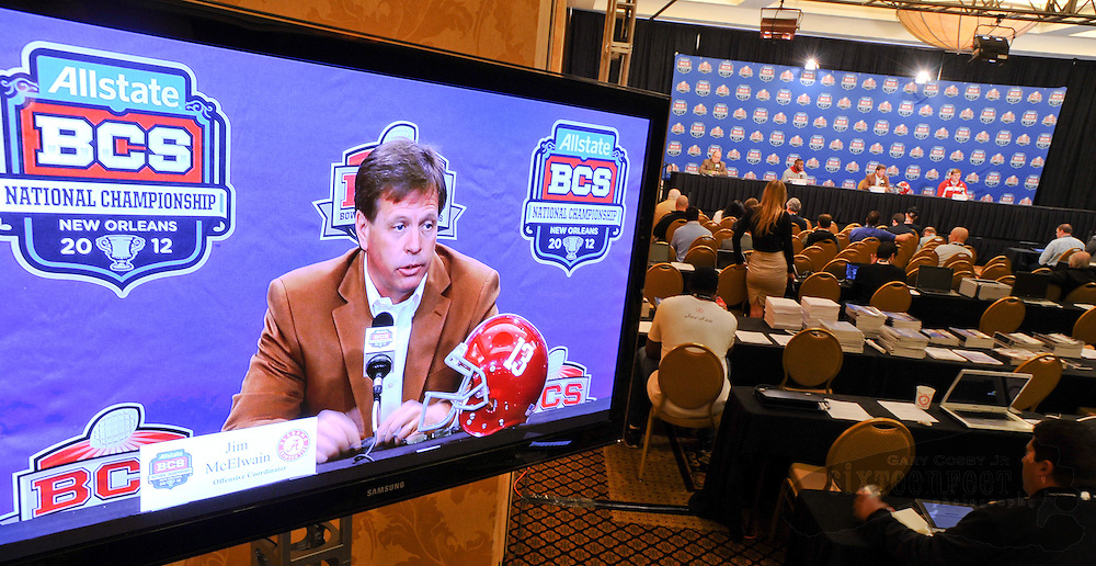 Daily Photo by Gary Cosby Jr.    ..Offensive coordinator Jim McElwain is seen in a large video monitor in the primary interview room as he address the media during the offensive press conference for the University of Alabama football team Thursday, January 5, 2012 in New Orleans...................................