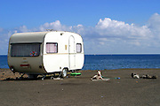 A dog guards a caravan near the beach of Playa De Melenar in Gran Canaria, Canary Islands, Spain.