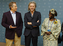 """Prime Minister Tony Blair (left) alongside Bob Geldof and Kenyan Nobel Laureate Wangari Maathai. Blair paid tribute to the anti poverty campaign led by Geldof himself- dubbing it """"the most extraordinary civic society campaign I have ever come across""""."""