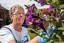 Pensioner in supported housing gardening