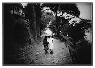 School girls sharing an umbrella, Darjeeling.