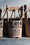 Water pails. Cemetery of Komyoji Temple, Kamiyacho, Tokyo, Japan, April 13, 2019. Matsumoto Shoukei is the author of A Monk's Guide to a Clean House and Mind (Penguin). He hold periodic cleaning sessions at his temple in Tokyo's Kamiyacho district.