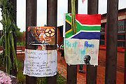 Messages to Madiba outside his former Soweto home. Crowds gather to mourn the death and celebrate the life of Nelson Rolihlahla Mandela outside his former home in Vilakazi street in Soweto. Johannesburg. South Africa<br />
