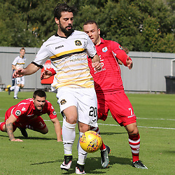 Dimitrios Froxylias gets to the ball first  during the Dumbarton v Connah's Quay Nomads Irn Bru cup second round 2 September 2017<br /> <br /> <br /> <br /> <br /> (c) Andy Scott | SportPix.org.uk