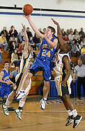 Chapel Field's Dustin Vellenga (24) takes a shot between John A. Coleman's Paul Letteri, left, and Chris Chatelain during the Section 9 Class D boys' basketball championship game at Mount Saint Mary College in Newburgh on March 5, 2010.