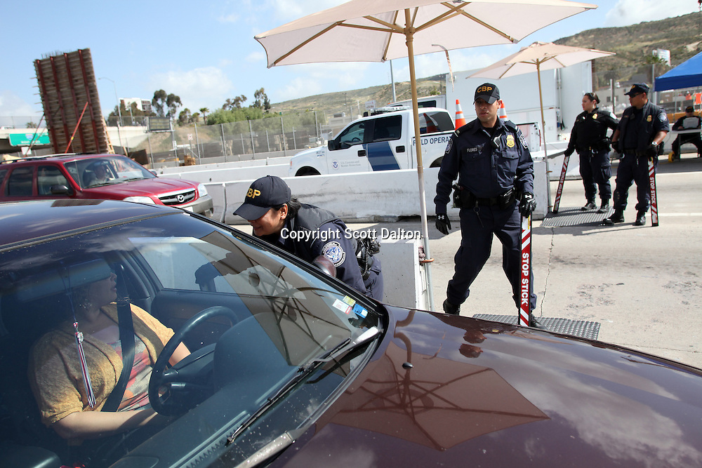 U.S. Customs and Border Protection agents check vehicles heading into Tijuana, Mexico at the San Ysidro border crossing in San Diego, California on April 30, 2010. The US government has stepped up inspections of vehicles crossing over to Mexico in an attempt to try to slow the flow of drug proceeds into Mexico. (Photo/Scott Dalton)
