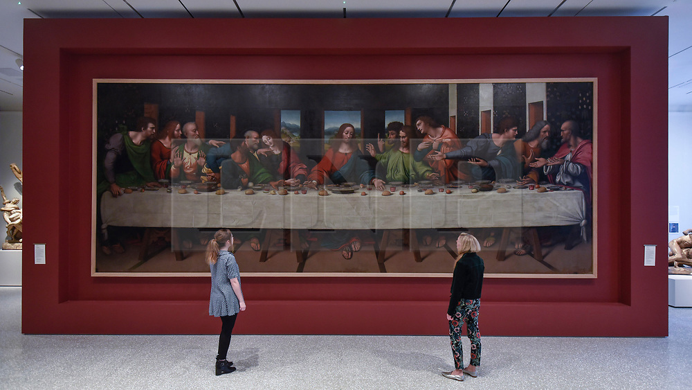 """© Licensed to London News Pictures. 14/05/2018. LONDON, UK. Gallery staff are seen in the new Collection Gallery viewing, (L to R) Leonardo Da Vinci 's """"The Last Supper"""", copy made 1515-20, at a photocall for the opening of the new Royal Academy of Arts (RA) in Piccadilly.  As part of the celebrations for its 250th anniversary year, redevelopment has seen the RA's two buildings, 6 Burlington Gardens and Burlington House, united into one extended campus and art space extending from Piccadilly to Mayfair.  Photo credit: Stephen Chung/LNP"""