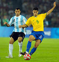 Here Argentine player JAVIER MASCHERANO and Brazilian ANDERSON de CARVALHO ANDRADE LIMA HERNANES at the mens semi-final soccer match in the Worker's Stadium at the Beijing 2008 Olympic Games August 19, 2008.<br /> ARGENTINA (3) Vs. BRAZIL (0)<br /> ©PikoPress