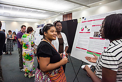 Curlis Joseph (L) and Latisha Ramsey (R) explain their research on the Nationality and Ethnicity and Zimbardo's Time Perspective Inventory to undergratuate psychology student Yoelika Liburd.  Fourteenth Annual Fall Research Symposium, St. Thomas Campus, College of Science & Mathematics.  23 September 2012. Administration and Conference Center (ACC).  University of the Virgin Islands.  © Aisha-Zakiya Boyd