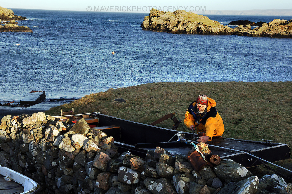Englishman Stuart Hill, who set up home in Shetland after getting shipwrecked on its shores, believes that the Crown never gained full ownership of the islands, which were handed to Scotland by a Norwegian King in the 1400s in lieu of a dowry for a royal wedding.  He has taken ownership of a tiny Shetland island called Forewick Holm, renaming it Forvik and calling for it to be recognised as a Crown dependency - Shetland, Scotland, UK - 25th January 2009.  Pictured Stuart checks the rigging on his home made boat that he uses to travel to and from Forvik weather permitting..