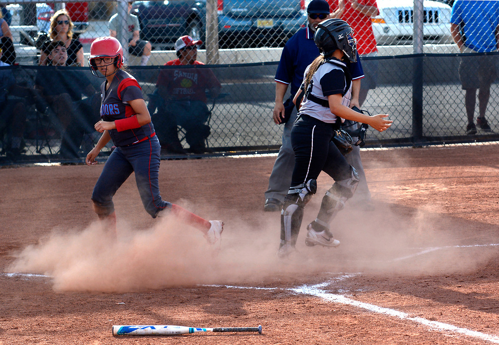 gbs032117h/SPORTS -- Sandia's  Ariana Velasquez scores in the 3rd inning during the game at Volcano Vista on Tuesday, March 21, 2017. (Greg Sorber/Albuquerque Journal)