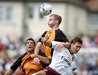 Photo: Jonathan Butler.<br /> Barnet v Arsenal. Pre Season Friendly. 14/07/2007.<br /> Mark Randall of Arsenal is out jumped by Neil Bishop.