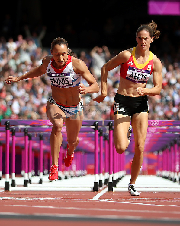 Jessica Ennis of Great Britian and Sara Aerts of Belgium cross the finish ilne during the 100m hurdles portion of the women's heptathlon during track and field at the Olympic Stadium during day 7 of the London Olympic Games in London, England, United Kingdom on August 3, 2012..(Jed Jacobsohn/for The New York Times)..