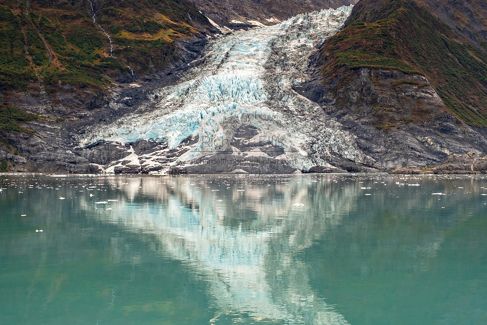 Cascade glacier reflected in waters of Barry Arm in Harriman Fjord, Prince William Sound near Whittier, Alaska.