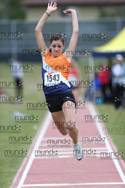 Jasmine Sweeney of Quinte Christian - Belleville competes in the junior girls long jump at the 2013 OFSAA Track and Field Championship in Oshawa Ontario, Thursday,  June 6, 2013.<br /> Mundo Sport Images / Sean Burges