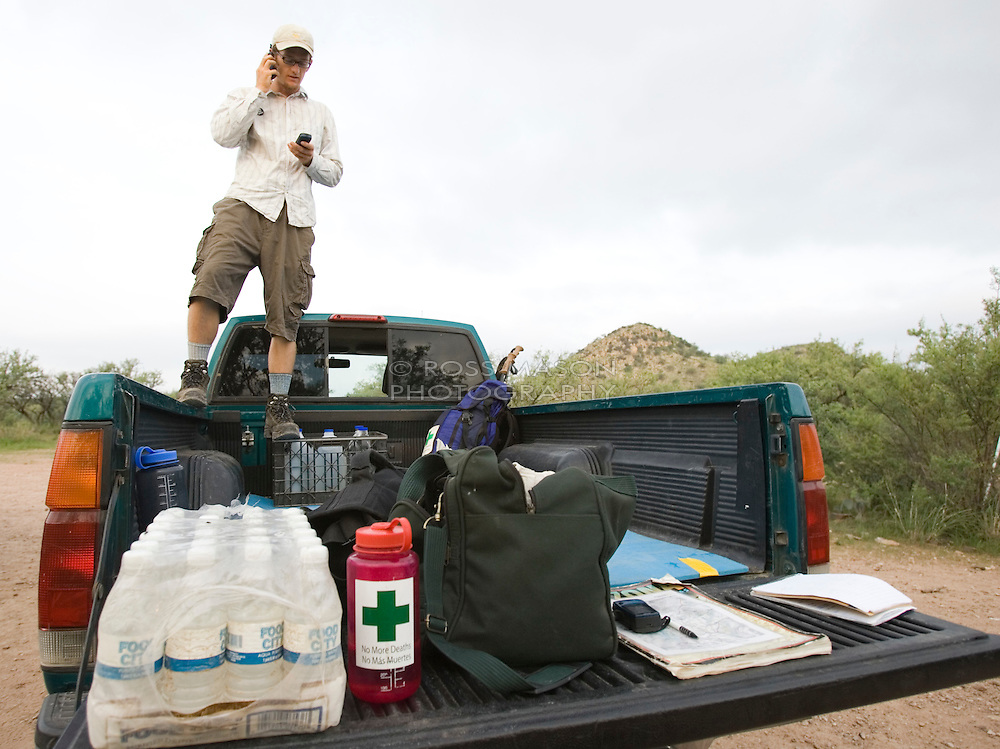 Walt Staton coordinates with a group of volunteers on patrol near the camp in Arivaca Arizona 15 miles north of the Mexico border. Staton leads patrols as well as escorting media personnel and visitors.