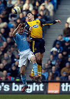 Photo: Jed Wee.<br />Manchester City v Wigan Athletic. The Barclays Premiership. 18/03/2006.<br /><br />Wigan's Paul Scharner (R) outjumps Manchester City's Sun Jihai.