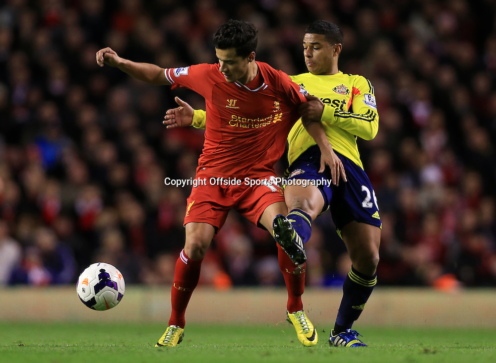 26th March 2014 - Barclays Premier League - Liverpool v Sunderland - Philippe Coutinho of Liverpool battles with Liam Bridcutt of Sunderland - Photo: Simon Stacpoole / Offside.
