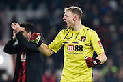 Aaron Ramsdale (12) of AFC Bournemouth celebrates the 3-1 win at full time during the Premier League match between Bournemouth and Brighton and Hove Albion at the Vitality Stadium, Bournemouth, England on 21 January 2020.