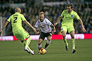 Derby County forward Johnny Russell takes on Brighton central midfielder, Dale Stephens (6) and Brighton defender, Bruno Saltor (2)during the Sky Bet Championship match between Derby County and Brighton and Hove Albion at the iPro Stadium, Derby, England on 12 December 2015.