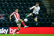 Preston North End forward Paul Gallagher (12) and Stoke City defender Tom Edwards (2) during the EFL Sky Bet Championship match between Preston North End and Stoke City at Deepdale, Preston, England on 21 August 2019.